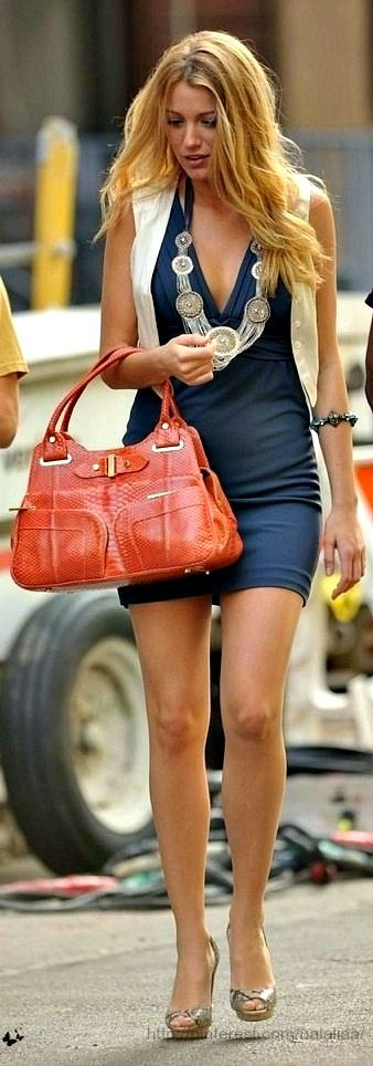 Blake Lively; love the Navy mini dress with the neutral shoes and vest with the coral orange purse and big necklace!
