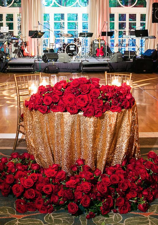 Gold Sweetheart Table with Red Rose Décor | Photo: Lin & Jirsa Photography.