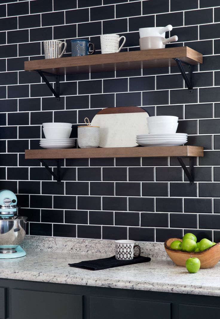 Timeless subway tile gets a modern update in a bla…