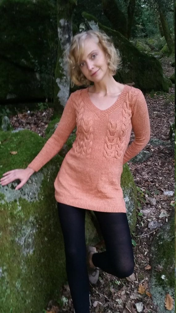 Small hand knit dress with nice cable pattern. You can wear it with leggings or like a long sweater with a pair of jeans or trousers. Nice soft