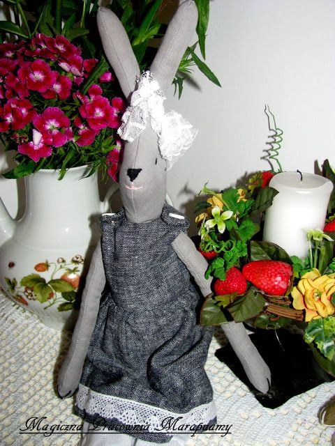 gray rabbit in flowers