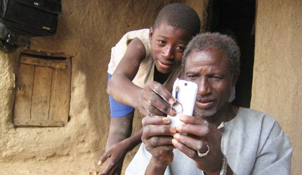 http://cdn.ict4d.co/img/Using-mobile-phones-in-Africa-where-Cloud-Computing-technology-delivers-digital-contents-to-the-users-increasing-literacy-rate-in-Africa-by-the-use-of-technology.jpg