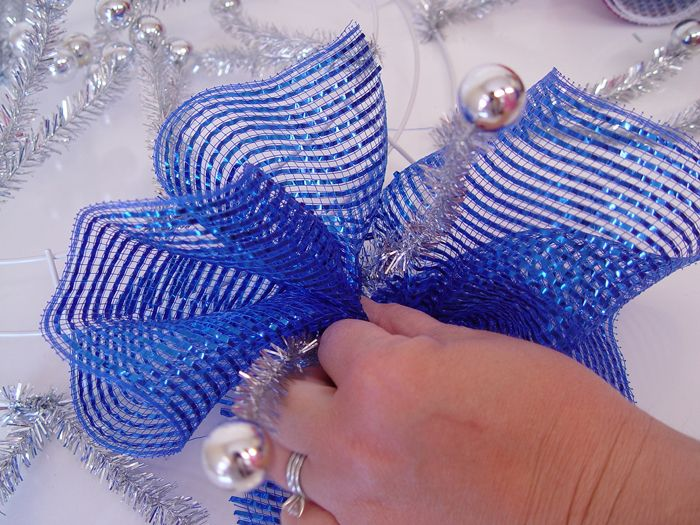 Ruffle Wreath Technique - Trendy Tree Blog http://www.trendytree.com/blog/patriotic-ruffle-wreath-tutorial-using-pencil-wreath-with-balls-10-wide-foil-deco-poly-mesh-and-ribbon/