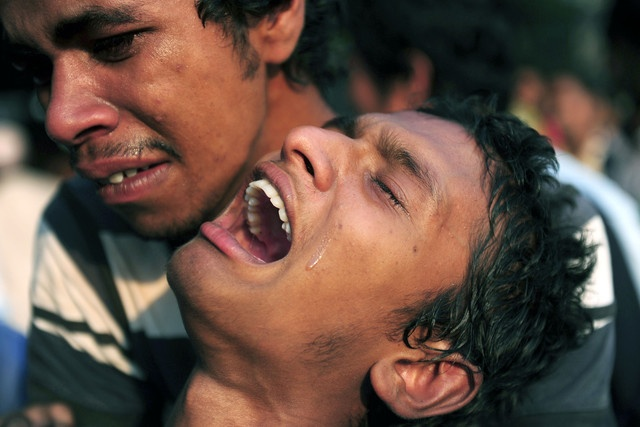 Horror in Bangladesh | A Bangladeshi youth reacts after seeing his relative's dead body after a building collapse in Savar, on the outskirts of Dhaka, on April 24, 2013. | Photo: Munir uz Zaman/AFP via Getty Images