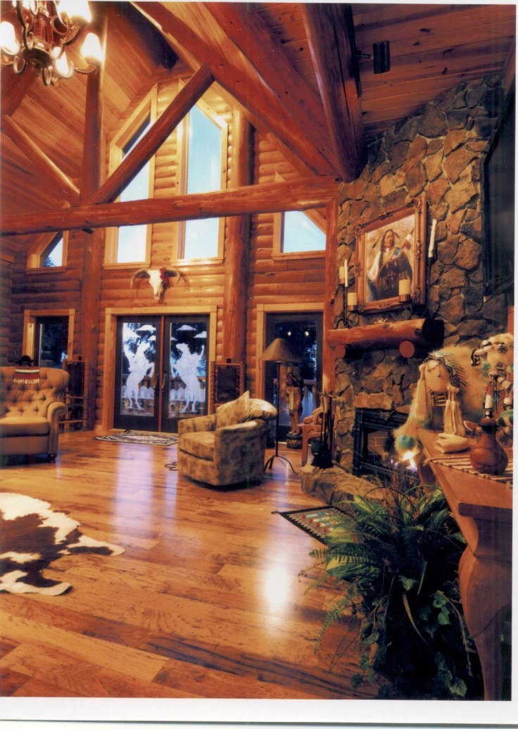 Love the windows, fireplace, and open space.