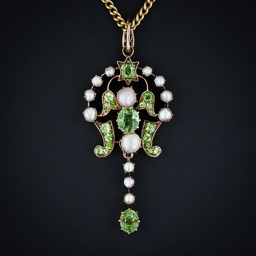 From Imperial (pre-Soviet) Russia comes this enchanting rose gold pendant necklace sparkling with rare and radiant Demantoid garnets and shimmering natural pearls. This gorgeous and graceful antique pendant measures 1 7/8 inches from the top of the Demantoid set bail to the tip of the freely swinging bottom drop by 7/8 inch wide. Russian hallmarks, circa 1880.