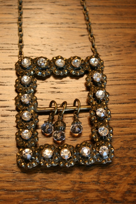 Vintage Belt Buckle Necklace with a few dangles .I have just bought two rhinestones belt buckles. Can't wait to use them.