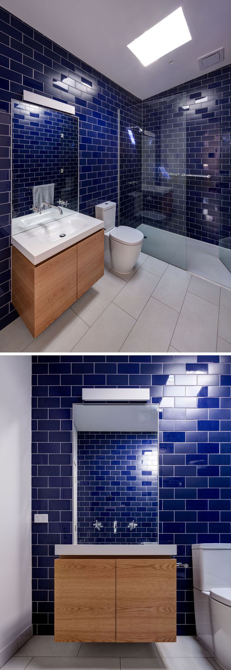 Dark blue tiles have been paired with white and wood in this contemporary bathroom.