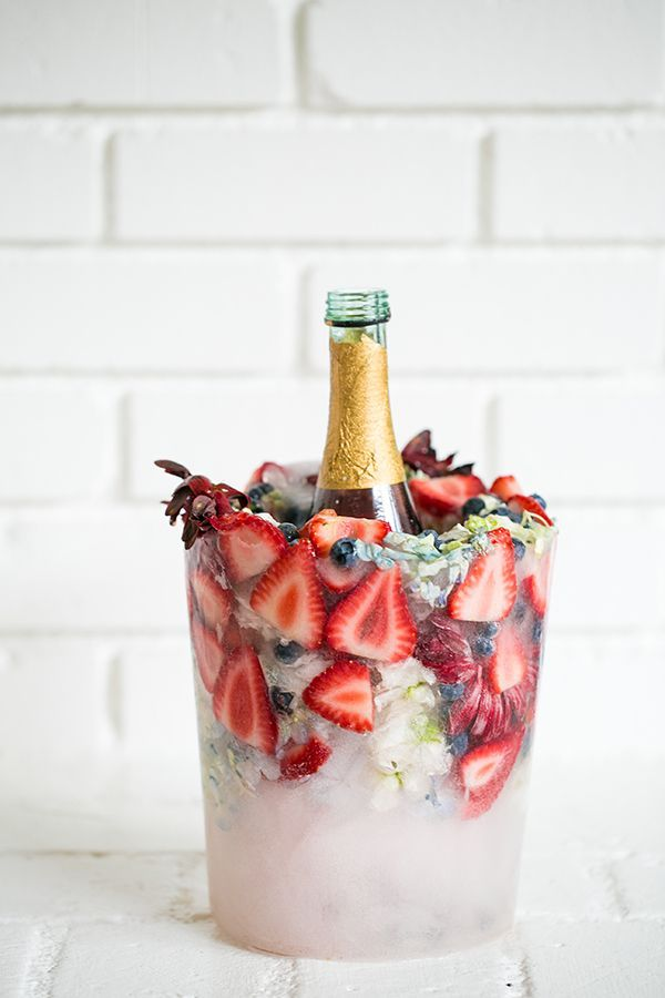 Be creative if you are hosting a party this weekend. DIY floral ice bucket to keep all your drinks cool during the warm weather  and bound to amaze your guests!