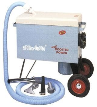 """Electro-Groom by ELECTRIC CLEANER CO. $599.95. Powerful animal vacuum groomer rolls easily on 8"""" wheels. Removes dirt, loose hair and parasites quickly and quietly. Two twin turbine motor units can be operated separately or together for maximum power. Large bushel capacity debris box has removable filter bag to catch overflow dust and debris. Includes 10' crushproof hose, swivel end, aluminum serrated nozzle, brush, and blower tip. Hose can also be attached to exhaust..."""