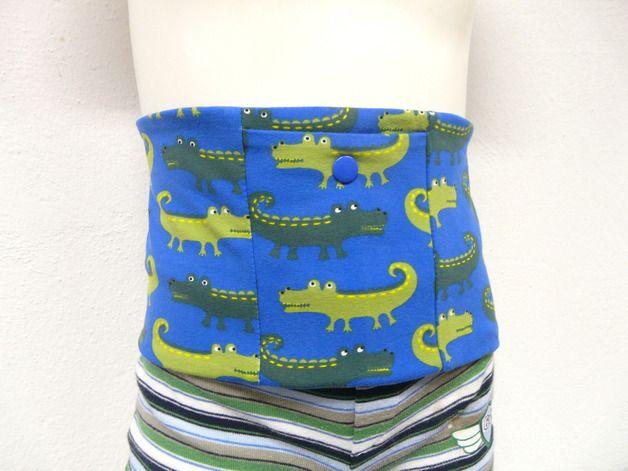 Bauchband aus Jersey im hinteren Bereich mit Druckknöpfen zum einfachen öffnen und schließen. Vorne eine Tasche für die Insulinpumpe ebenfalls mit einem Druckknopf für den besseren Halt der Pumpe in der Tasche.