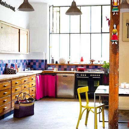Another great kitchen using recycled wood items. I'm not one for the coloured tiles or pink curtains but love this concept.