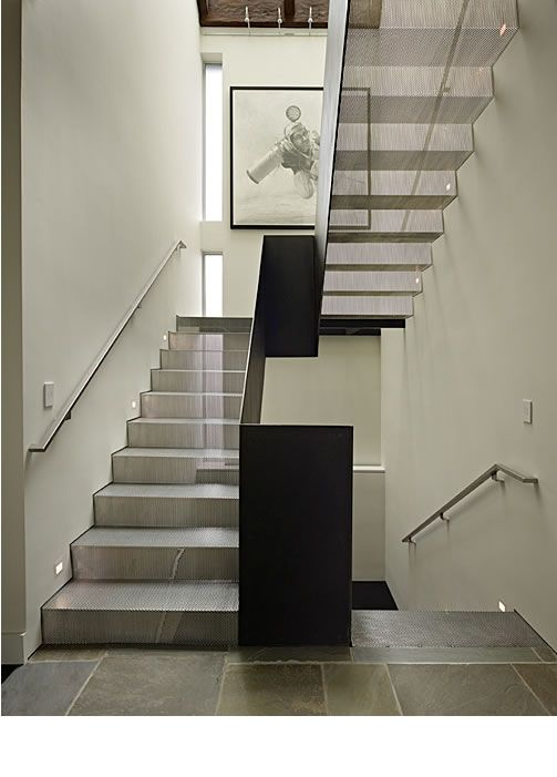 Steel staircase with mesh treads and risers. Solid steel ...
