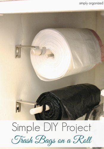 Maximize your under-the-sink space, and store your trash bags on a roll. Source: Simply Organized