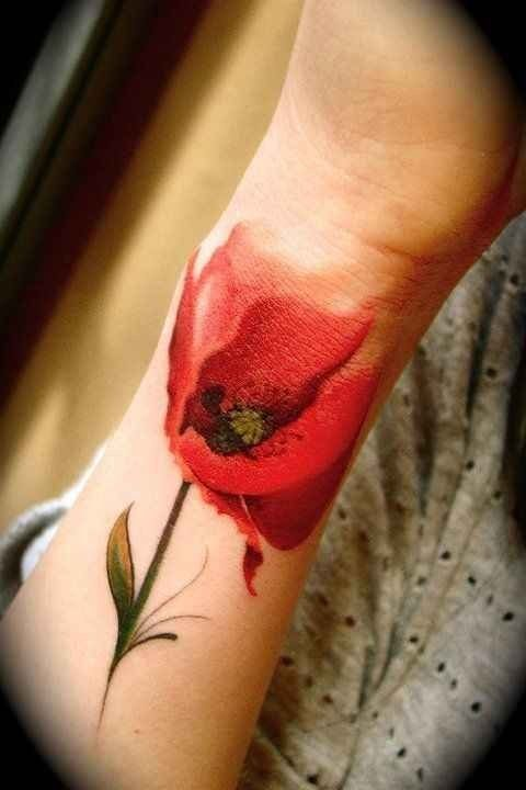 Realistic red poppy tattoo on wrist
