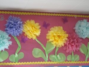 tissue paper flower bulletin board....take this idea and turn it vertical and make vines as a way to go up the wall and across for picture time.