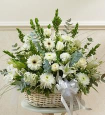 "This garden basket features flowers in white tones to express your sympathy. Our designers use only the freshest flowers making this basket a wonderful way to honor a loved one. *Arrangement measures approximately 28""H x 24""L"