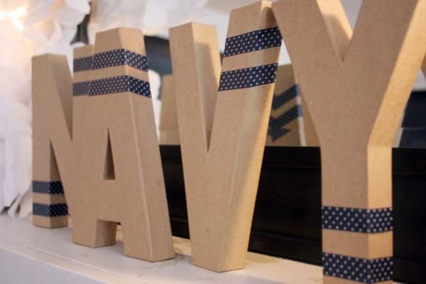 CUTE & INEXPENSIVE child or last name decor IDEA! Get cardboard letters from craft store and add washi tape! Via Kara's Party Ideas | KarasPartyIdeas.com