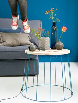 Table made from a lamp frame. The description is in Dutch but it's fairly easy: take an old lamp, strip it, and paint it blue. Also take good wood, cut it in the desired size and attach to the frame!