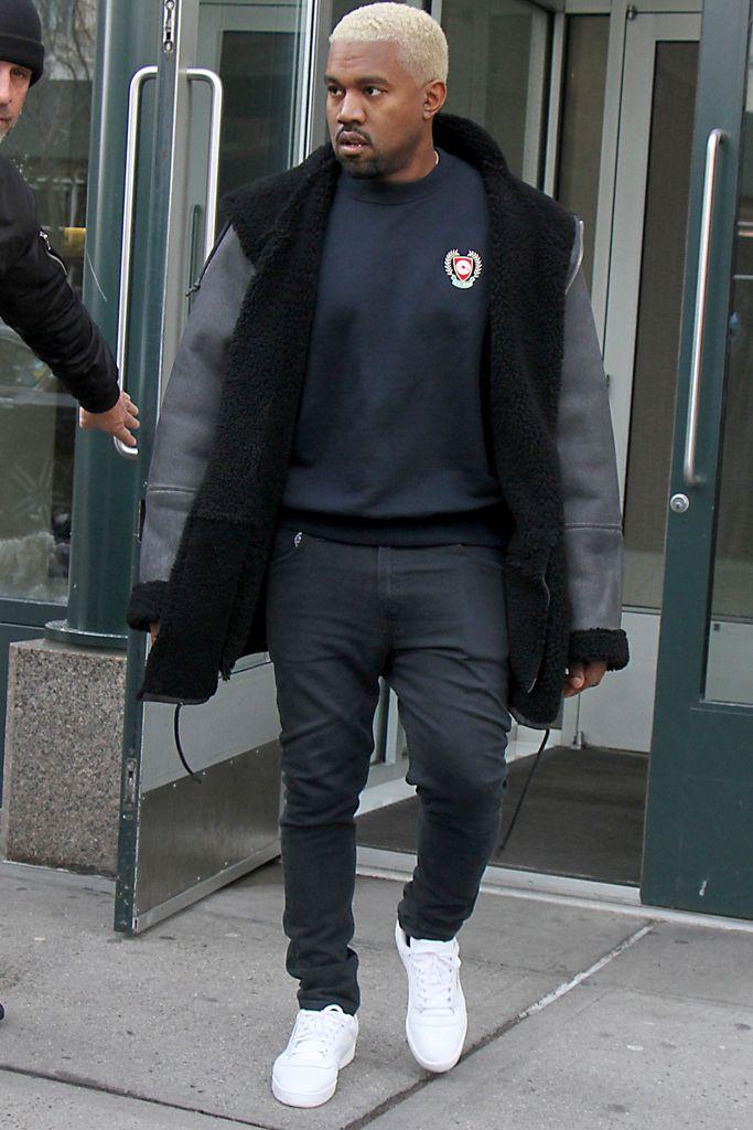 Kanye West wearing his Calabasas x Adidas Powerphase sneakers.