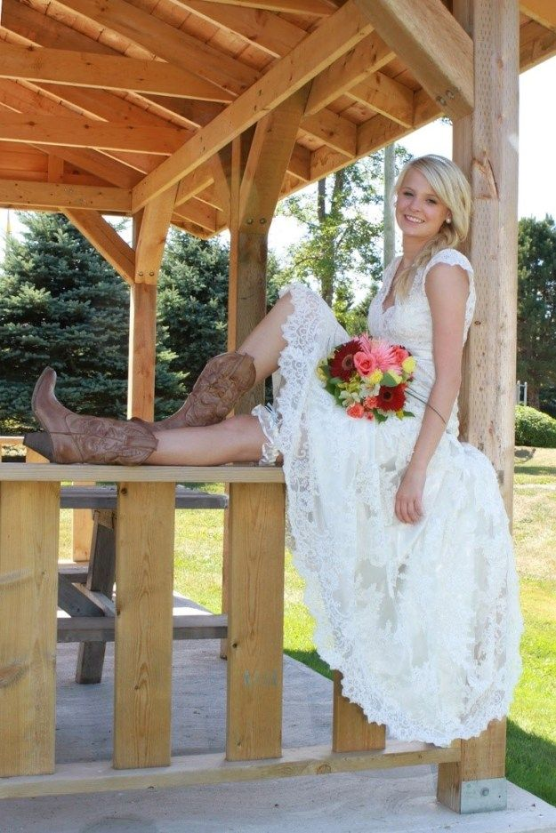 Lace Wedding Dress, Garter, Bouquet and Cowboy Boots... the perfect wedding ensemble! | topwedding.com