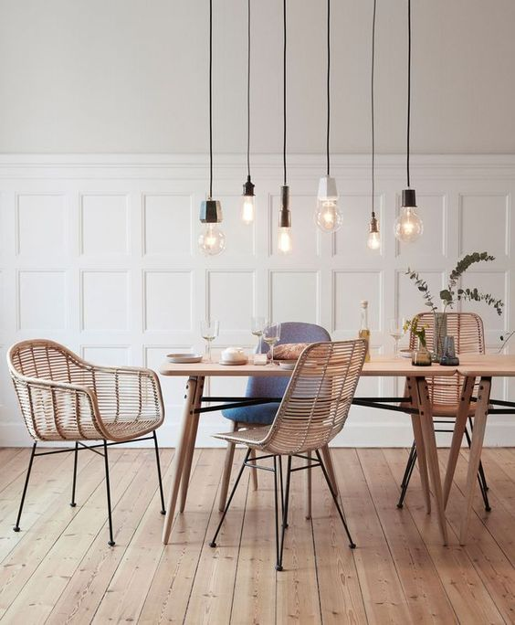 minimal dining room | light bulb pendants | rattan chairs and wooden table | white wood panelling