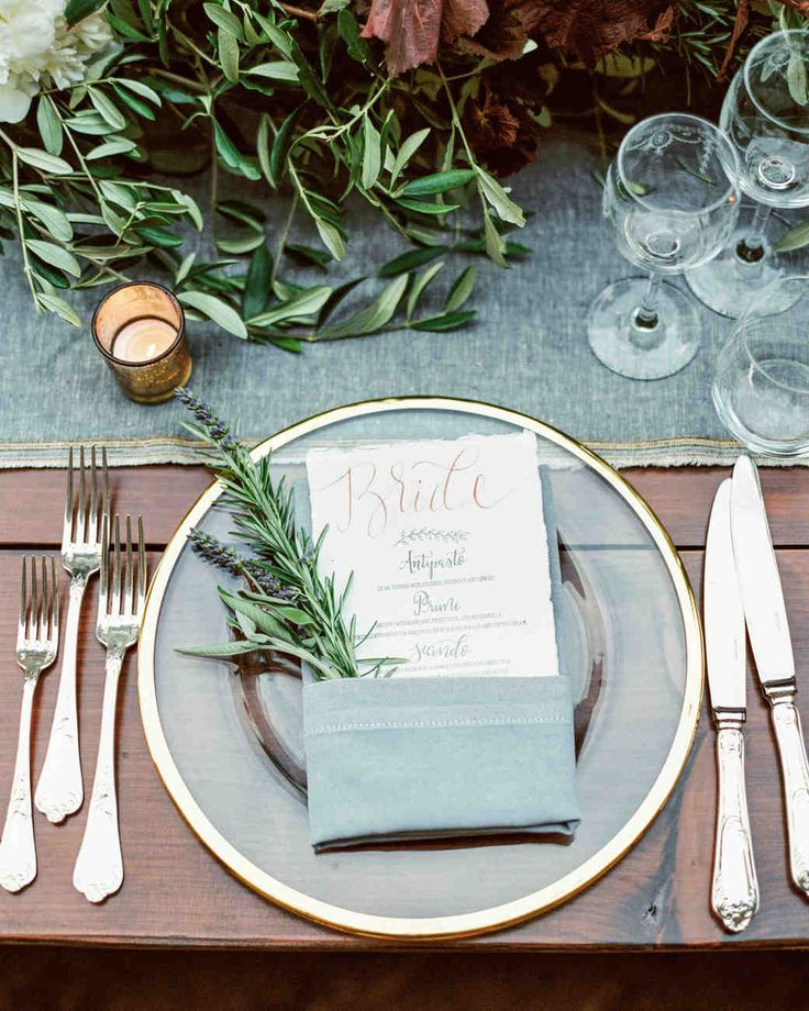 This Romantic Italian Wedding Features a Historic Venue—and One Amazing View | Martha Stewart Weddings - Clear, gold-rim plates set with menus doubling as place cards graced each seat.