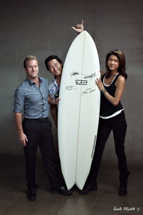 Surfboard signed by Alex O'Laughlin, Scott Caan, Daniel Dae Kim and Grace Park. Buy a ticket for a chance to win: http://www.gaylaelizabethblog.com/2012/03/13/win-a-surfboard-autographed-by-hawaii-5-0-cast/   For Life Rolls On Charity.