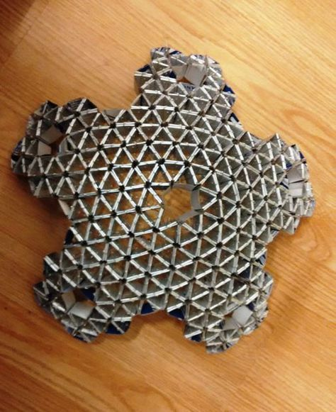 This origami sphere is made of recyclable milk cartons. Theused milk cartons are cut into strips to form triangles by folding them, and by connecting those triangles... #recyclingmilkcartons