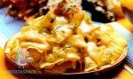 Receta de Nachos con salsa de queso cheddar