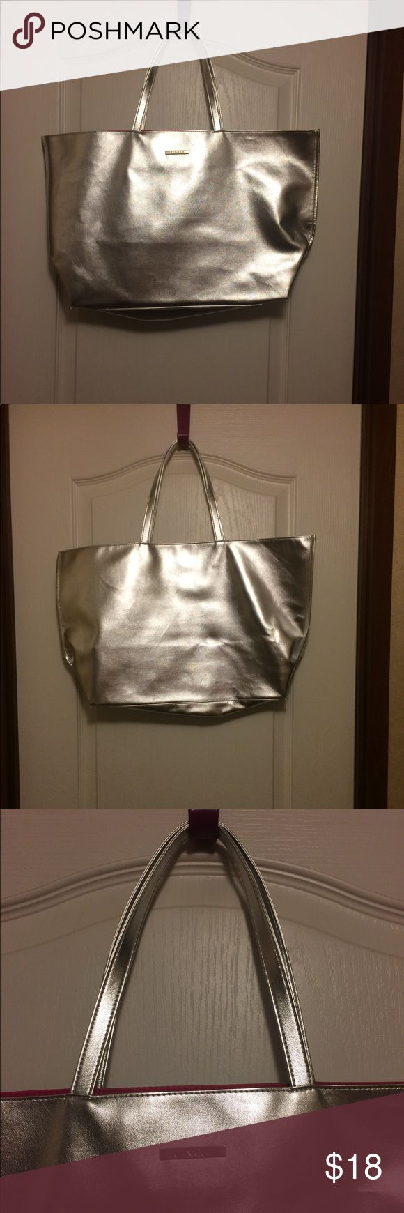 Clinique Silver Tote Bag Nice size silver Clinique tote bag. Bright pink on inside. Beautiful bag, super shiny. EUC. Clinique Bags Totes