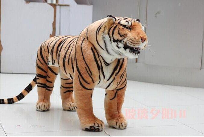 Дешевое Огромный тигр игрушки моделирование желтый стоя тигр кукла большой куклы подарок на день рождения около 110 x 70 см, Купить Качество Набивные плюшевые игрушки непосредственно из китайских фирмах-поставщиках:        Размер около 110x70 см, это около 8 кг.                Размер пакета составляет около 100x30x70 см, Весь ве