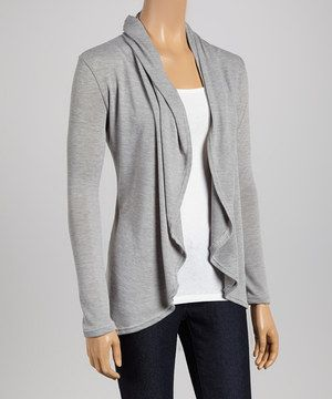 A sweet staple should be comfortable, stylish and endlessly wearable. Luckily, this cozy cardi fits the bill. Its tapered open placket exudes casual appeal, and a classic hue promises ample styling opportunities.