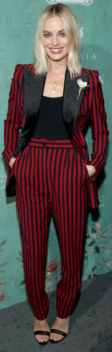 Who made Margot Robbie's red stripe pants, sandals, shirt, and black blazer?