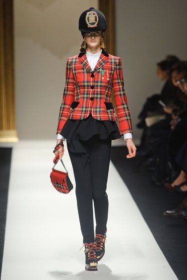 Moschino Fall 2013 - From the Scottish highland tartans to the strictly Brit pop soundtrack, Rosella Jardini paid homage to the British Isles.