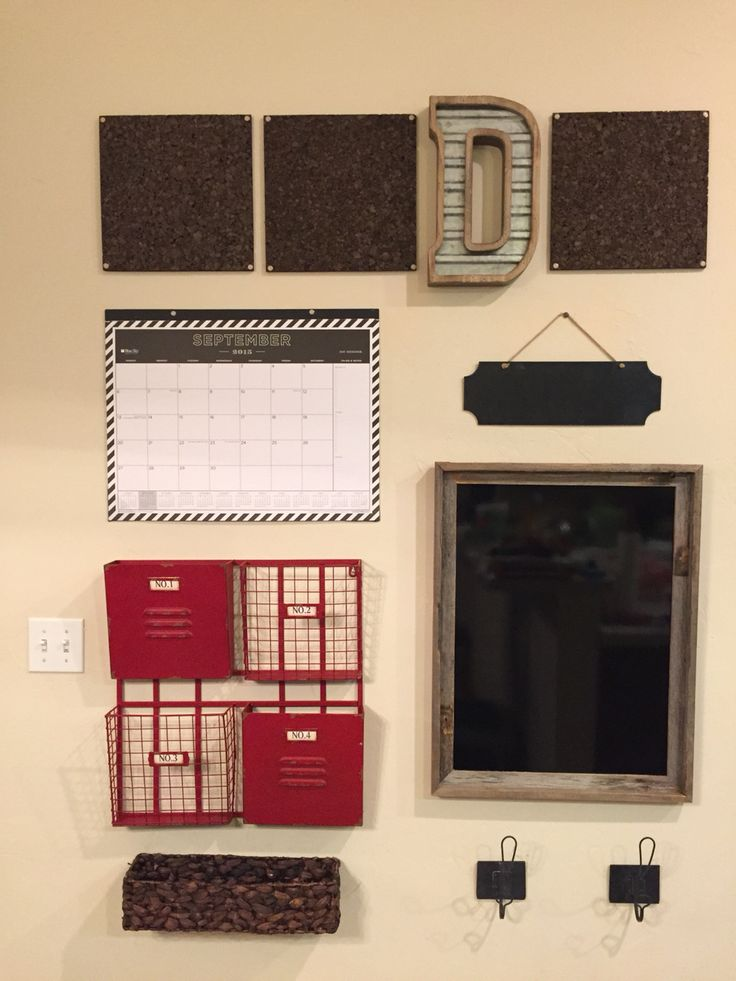 """Loving my new family command center! Everything was purchased at Hobby Lobby 50% off. From the top down - Square cork boards  nailed in and nails covered with decorative push pins (pins from Target) - Decorative """"D"""" - Desk Calendar (Target) - Small chalk board - Red Sorter - 18x24 black dry erase board inserted into a rustic frame - Small basket nailed to wall to hold markers and such - Decorative hooks. I organized this pretty low to the ground so my children could easily access things."""