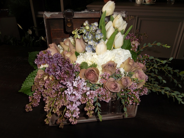 Lavender Roses And Liliacs In The Over Flowing Treasure Chest Graced Tables At This Spring