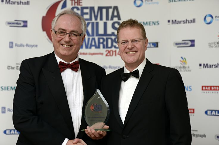 Stephen Ollier of Pentaxia Limited receives the Skills Champion of the Year from BAE Systems' Nigel Whitehead.