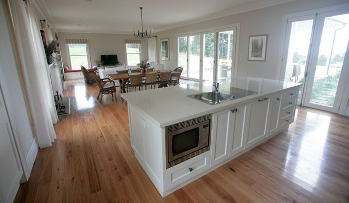 Love the timber flooring through and the fresh island bench in white.