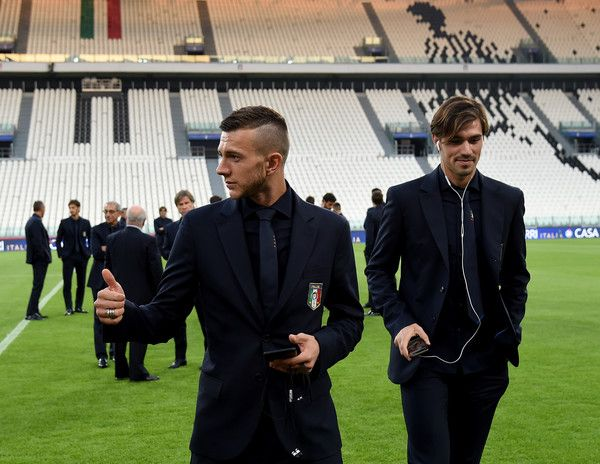 Federico Bernardeschi (L) and Alessio Romagnoli of Italy attend prior to the press conference at Juventus Stadium on October 5, 2016 in Turin, Italy.