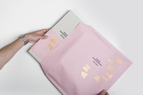 packaging in gold & black:  candy pink and gold envelope (graphic design, print, packaging)