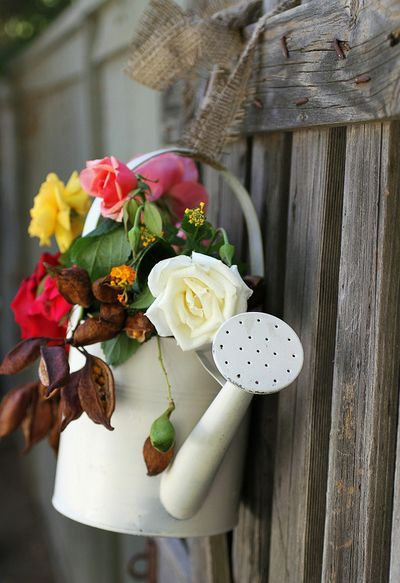 Watering Can and flowers.. lovely