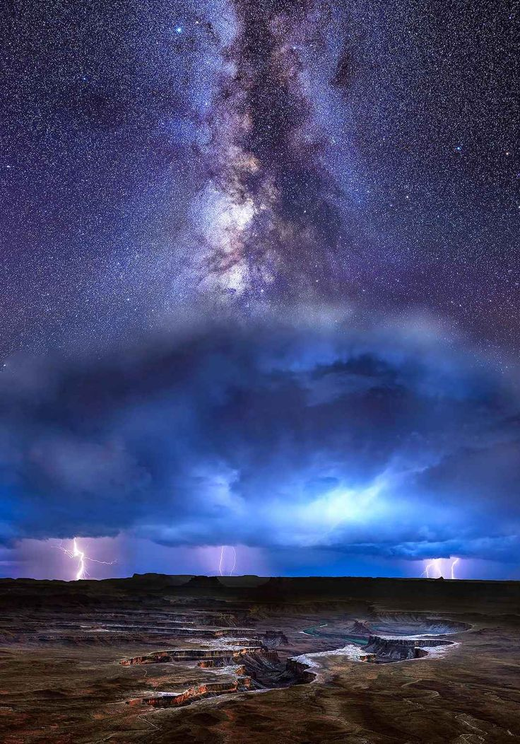 Pic by Klaus Priebe/Caters News (Pictured: Milkyway captured during a breath-taking lightning storm in Canyonlands of Utah, USA) - - Incredible snaps of the Milky Way along with wonderful landscapes in the four corner states of Colorado, New Mexico, Utah, and Arizona. Photographer Klaus Priebe took the images at the picturesque canyons during monsoon season. In one image the Milky Way can be seen in all its glory above a ferocious storm in the Canyonlands of Utah. SEE CATERS…