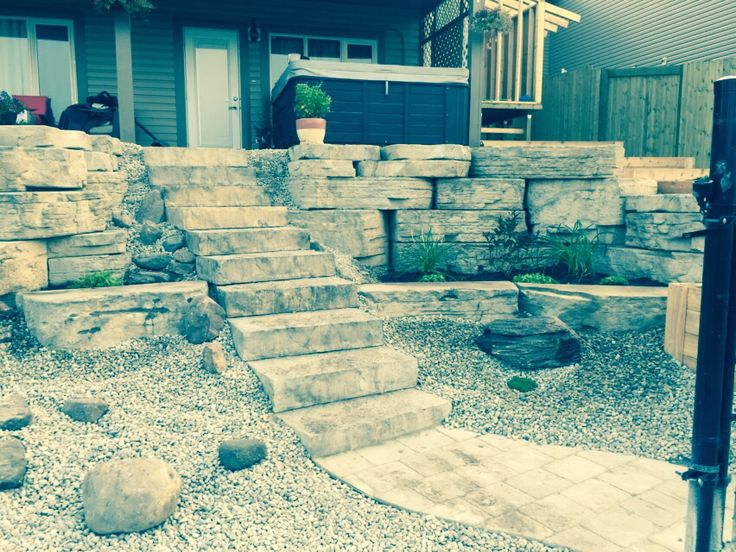 Natural stone wall built by Karch Properties Inc. ....
