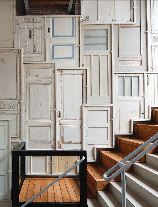 Dutch designer Piet Hein Eek adorned the lofty foyer walls of a new residental development entirely with old timber doors, bathroom doors, office doors, front doors and back doors to preserve the memory of the buildings that were torn down, to make way for a residential development.  The result is a jaw-dropping foyer installation and a visual reminder of what once was.