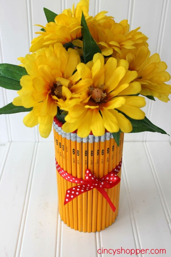 If you are needing a great DIY Teacher Gift this Pencil Vase would be perfect. We made this adorable vase with some Dollar Store supplies and a flower arran