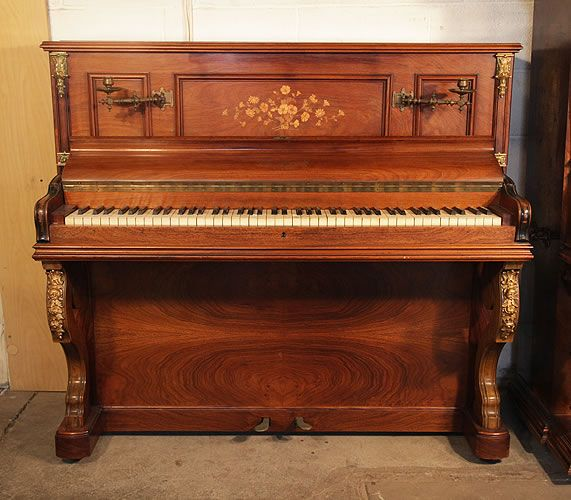 A Bord upright piano with a mirrored, rosewood case at Besbrode Pianos. Cabinet features floral inlaid panels and ormolu mounts. The Bord piano company was purchased by Pleyel in 1934.
