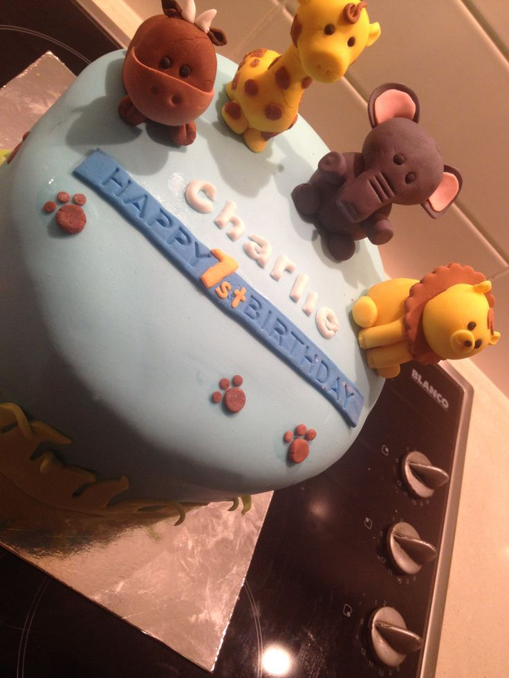 Jungle theme 1st birthday cake for Charlie. Chocolate cake iced w/ chocolate buttercream