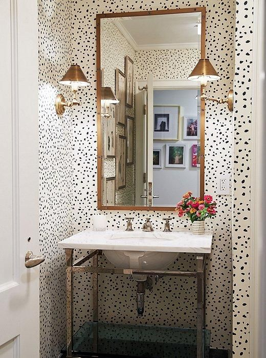 "Lilly keeps major walls white but sees no need for restraint in a powder room: ""You have less space and less clutter, so you can go for it,"" she says."