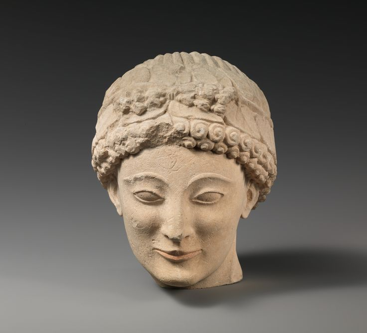 Limestone beardless male head with ivy wreath Date: late 6th or early 5th century B.C. Culture: Cypriot